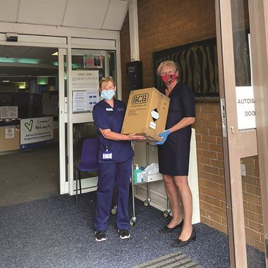 CEO Janey Howell Donating hand sanitiser to Velidre Cancer Centre